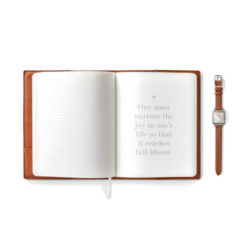 The watch comes packaged in a wooden watch box, including a leather-bound journal containing excerpts from Dr. Angelous poetry and a booklet honoring the life and legacy of the acclaimed author/activist.