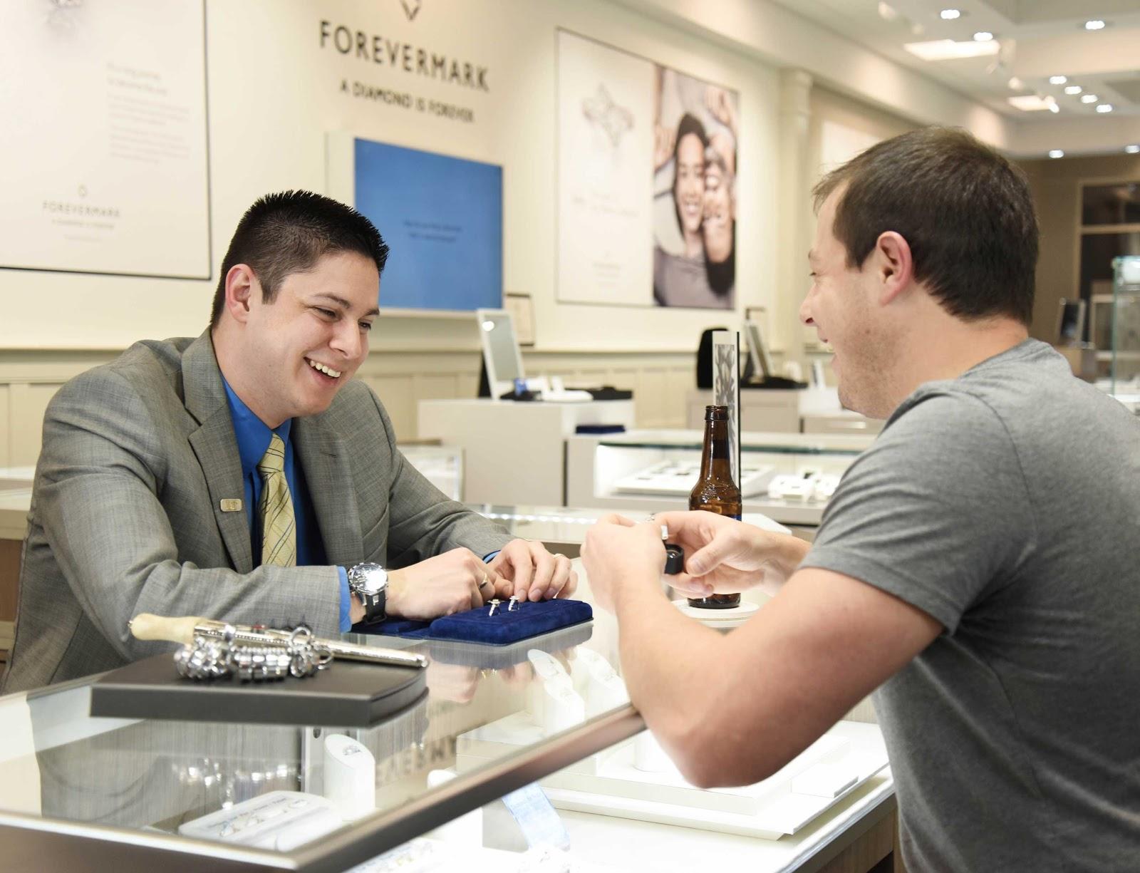 shopper enjoying a beer discussing custom design options